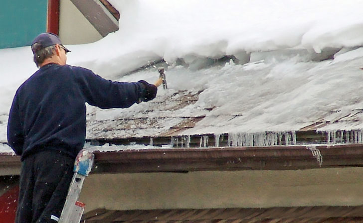removing an ice dam to prevent water damage in aspen, colorado