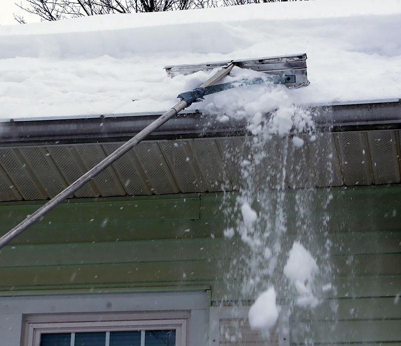 snow removal from roof with a snow rake